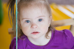 Emotions of a little baby girl with Down syndrome Royalty Free Stock Photo