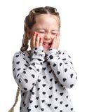 Emotions. Little curly to hold his cheeks with his hands and shy. White isolated background Stock Image
