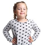 Emotions. Little curly girl posing. White isolated background. Emotions. Little curly girl posing hands in the sides and a slight smile. White isolated Stock Image