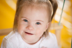Emotions of a little girl with Down syndrome Stock Photo