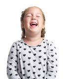 Emotions. The little girl laughs hard. White isolated background. Emotions. The little curly girl laughs hard with her eyes closed. White isolated background Stock Image