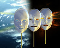 Emotions are masks - like night and day. Dramatic masks, ceramic on golden handles presented against a backdrop of night becoming day. The idea is to represent Stock Photo