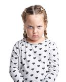 Emotions. Offended little girl. White isolated background. Emotions. Offended little curly girl in a gray sweater. White isolated background Stock Image