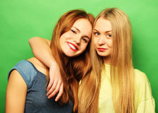 Emotions, people, teens and friendship concept - smiling pretty. Emotions, people, teens and friendship concept - happy smiling pretty teenage girls or friends Stock Photography