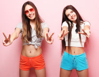 Emotions, people, teens and friendship concept - two young teen Stock Photos
