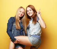 Emotions, people, teens and friendship concept - two young teen Stock Images