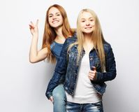Emotions, people, teens and friendship concept - two young teen girls. Emotions, people, teens and friendship concept - two beautiful young teen girl giving Stock Photo