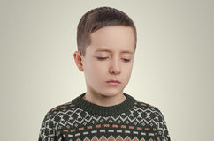 Emotions. Sad boy looking down. stock photo
