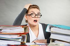 Panicked secretary at desk. Emotions shock corporation clerk administration concept. Panicked secretary at desk. Young nervous lady doing job in office Stock Images