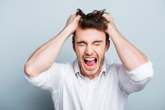 Emotions, stress, madness and people concept - crazy shouting ma Royalty Free Stock Photo