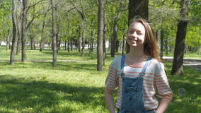 Emotions of a teenage girl. A teenage girl with freckles laughs in the park. Girl on the nature with soap bubbles. stock video