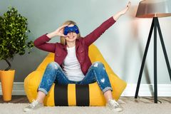 Woman sit on chairs bags and play video games . Emotions. Woman sit on chairs bags and play video games royalty free stock photography