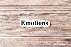 EMOTIONS of the word on paper. concept. Words of EMOTIONS on a wooden background Stock Photo