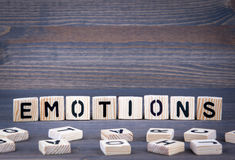 Emotions word written on wood block. Dark wood background with texture Royalty Free Stock Images