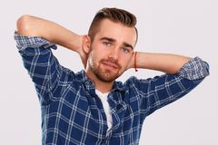 Emotions. Young man in blue shirt Stock Photos