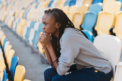 Emotiontal portrait of the afro-american girl worrying about the match on the stadium. Emotiontal portrait of the afro-american girl worrying about the match on Royalty Free Stock Photography
