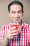 Emotive boy drinking Stock Images