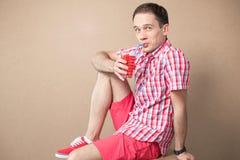 Emotive boy drinking Stock Photography