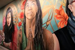 Gorgeous talent in artwork showing three strong women painted of wall inside Memorial Art Gallery, Rochester, New York, 2017. Emotive painting of three strong stock photos