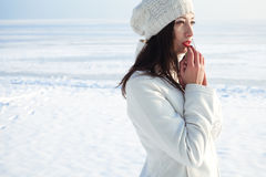 Emotive portrait of fashionable model in white coat and beret Stock Image