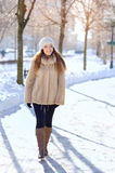 Emotive portrait of a fashionable model in white coat and beret Stock Photography