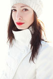 Emotive portrait of fashionable model in white coat and beret. Emotive portrait of a fashionable model in white coat and beret. Sunny weather. French style stock image