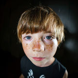 Emotive portrait of red-haired freckled boy, childhood concept Stock Photography