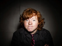 Emotive portrait of red-haired freckled boy, childhood concept Stock Image