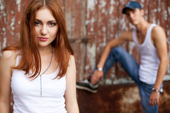 Emotive portrait of a stylish couple in jeans standing near wood Royalty Free Stock Images