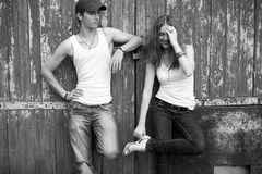 Emotive portrait of a stylish couple in jeans standing together Stock Photography