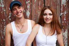 Emotive portrait of a stylish smiling couple standing together n stock image