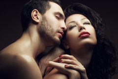 Emotive portrait of two lovers - handsome man and gorgeous woman. Emotive portrait of two lovers - handsome men and gorgeous women with perfect hair and skin royalty free stock photography