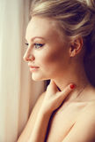 Emotive portrait of young beautiful woman with long blonde hair. Royalty Free Stock Photo
