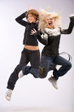 Emoution jumping two girl Royalty Free Stock Photo