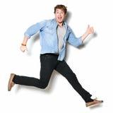 Emozionante felice di salto dell'uomo Immagini Stock