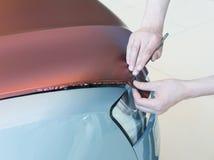 Empâtage du plastique carbonique de voiture image stock