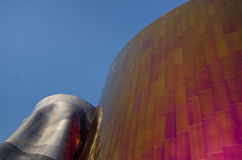 The EMP Museum. Vibrant colors of the sheet metal facade of the ultra-modern EMP Museum are reflected in the sun. The 140,000 square foot music and pop culture Stock Photo