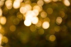 Empañe el bokeh ligero de oro por Feliz Año Nuevo Imagenes de archivo