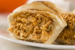 Empada Brazilian snack. pie with chicken on white plate on woode Stock Images