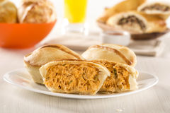 Empada Brazilian snack. pie with chicken on white plate on woode Stock Photography