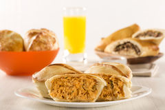 Empada Brazilian snack. pie with chicken on white plate on woode Royalty Free Stock Images