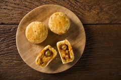 Empada Brazilian snack. pie with shrimp on wood plate on wooden Stock Images