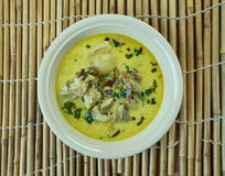 Empal gentong. Indonesia spicy curry-like beef soup originated from Cirebon, West Java Stock Photo