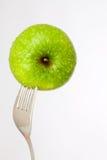 Empalado con la fork Foto de archivo libre de regalías