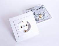 Empalme eléctrico dos en fondo ligero Imágenes de archivo libres de regalías