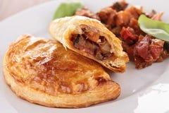 Empanada. Plate of baked empanada and vegetables Royalty Free Stock Photo