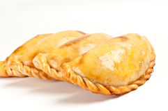 Empanada closeup. Group of Latin american empanadas. The Empanada is a pastry turnover filled with a variety of savory ingredients and baked or fried Stock Photography
