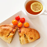 Empanada and a cup of tea Stock Images