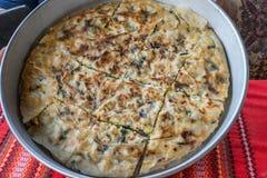 Empanada de la patata con las verduras y el queso Foto de archivo