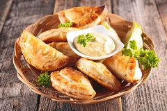 Empanada and sauce. Empanada with minced beef and sauce Royalty Free Stock Image